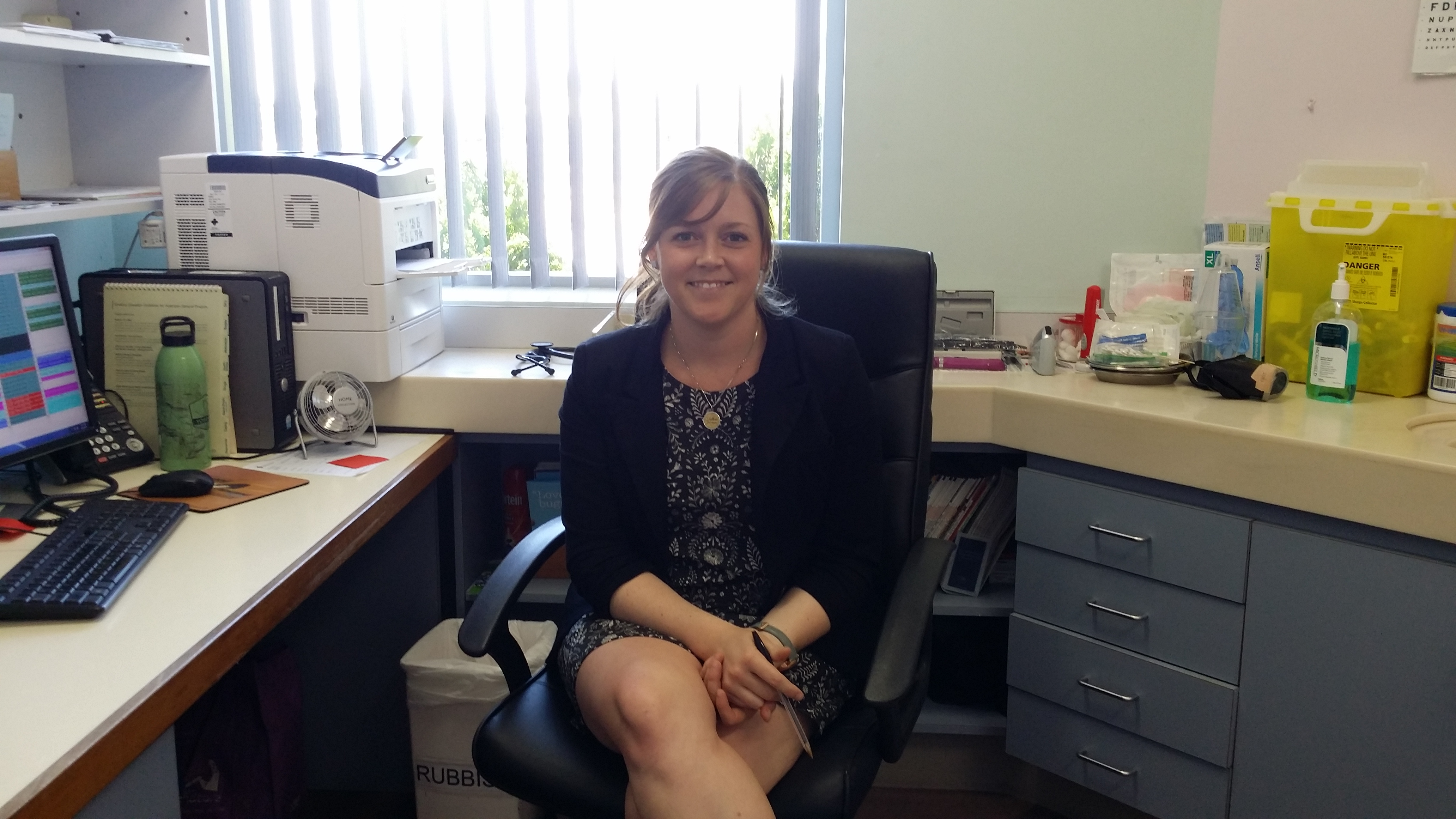 Joh Kelly in her office
