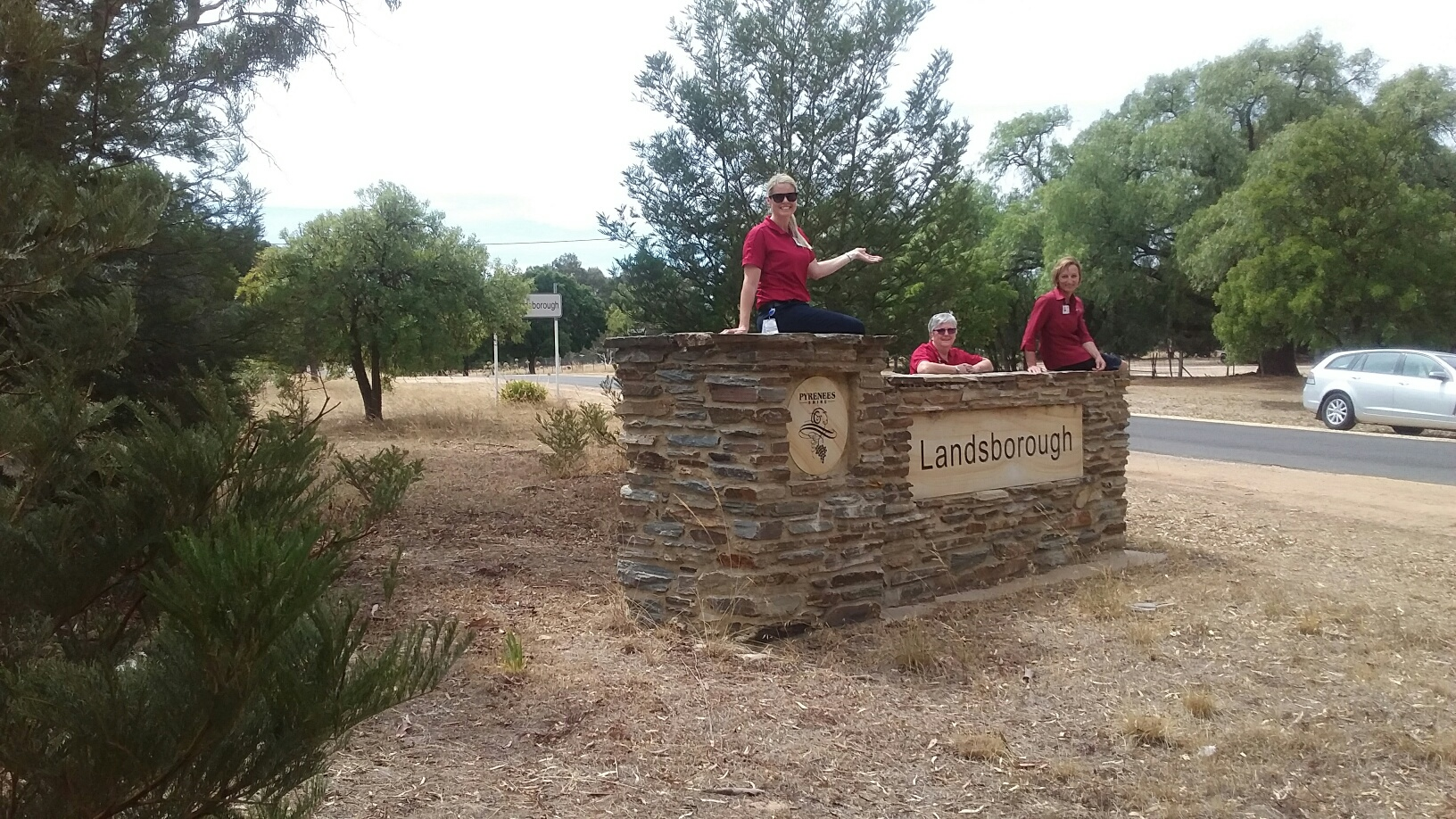 Stawell Regional Health Allied Health staff sitting on and leaning against the Landsborough entrry sign