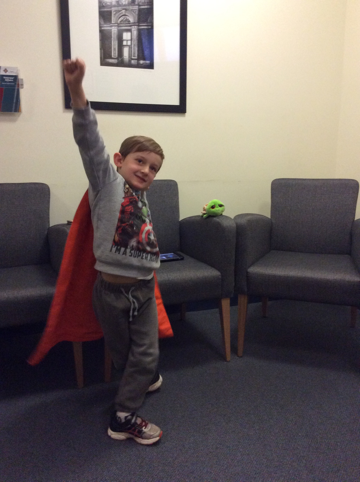 child wearing cape